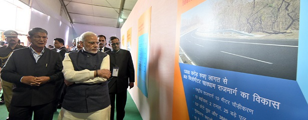 The Prime Minister, Shri Narendra Modi visiting an exhibition during the launch of the Char Dham Rajmarg Vikas Pariyojna, at Dehradun, Uttarakhand on December 27, 2016. 	The Chief Minister of Uttarakhand, Shri Harish Rawat is also seen.