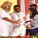 PM distributing the aids and assistive devices to Divyangjan