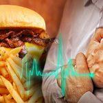 Men in white shirt having chest pain - heart attack - heartbeat line