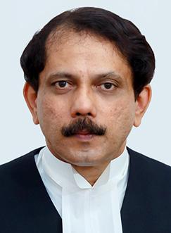 Justice Conrad Stansilaus Dias